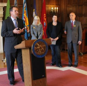 Gov. Steve Bullock with District Judge Ingrid Gustafson, Senator Cynthia Wolken and Department of Corrections Director Mike Batista announce the start of the Justice Reinvestment Initiative in Montana.