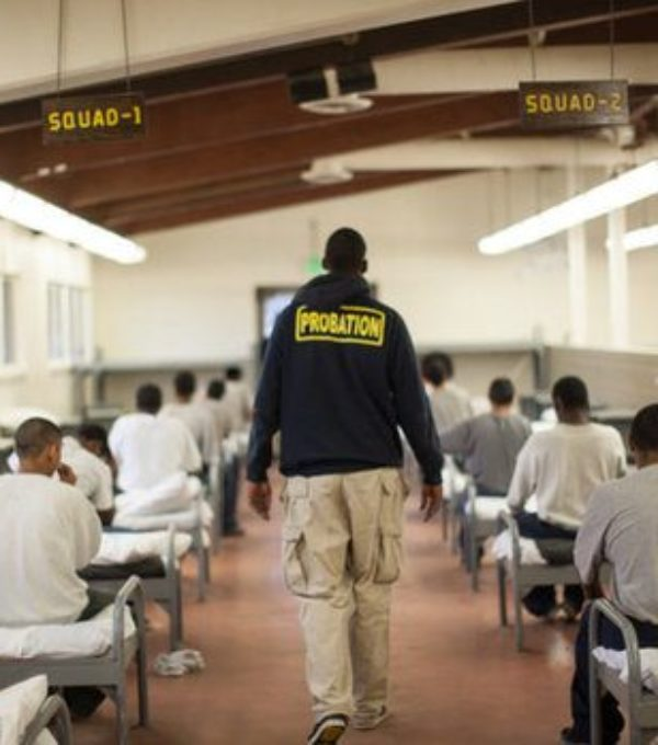 Photo of probation officer walking in a facility.